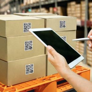 Man using tablet with digital tools and applications to improve supply chain sustainability.